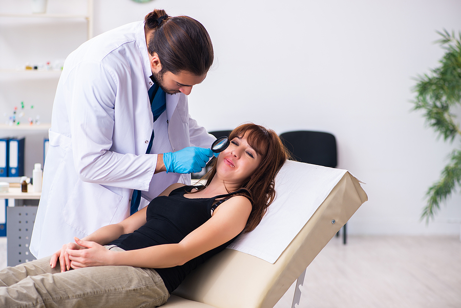 Woman visiting a male doctor dermatologist in a skin clinic in Melbourne