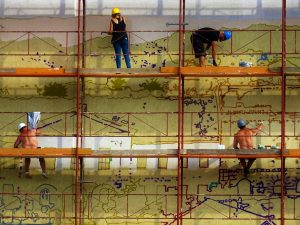 Workers while using scaffolding