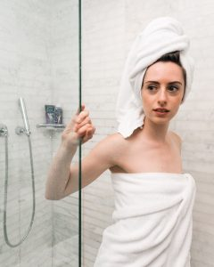 Woman coming out from a shower box